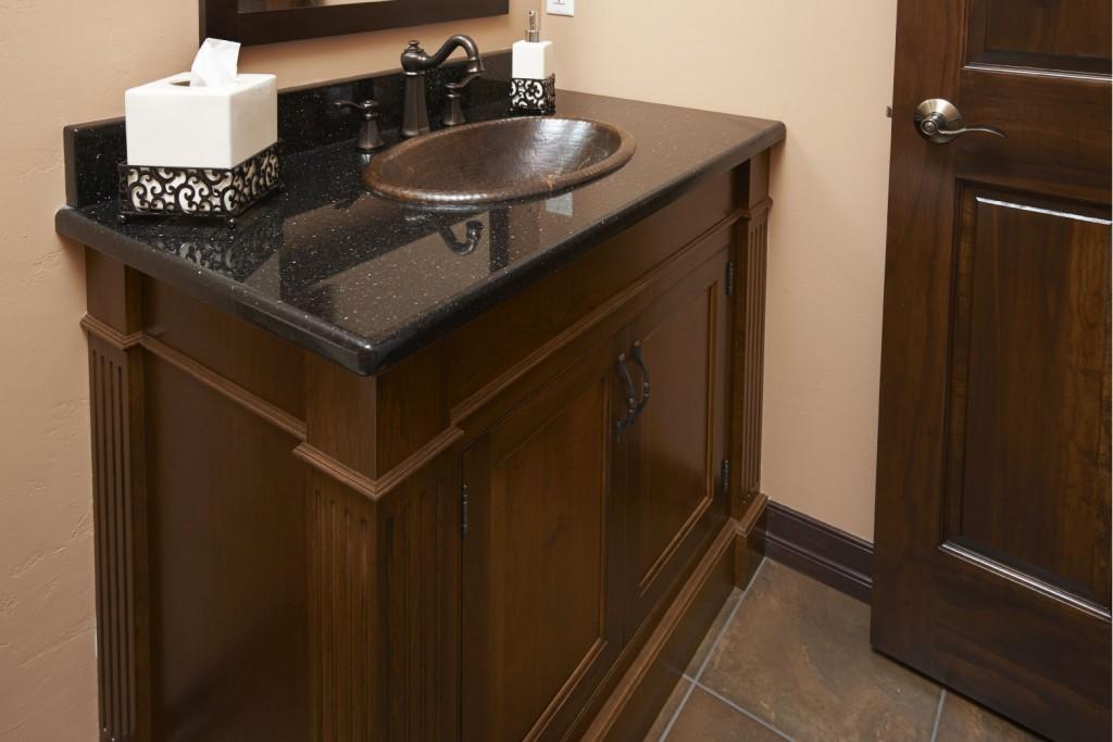 Alder vanity with Java Stain. Woodbridge Door, Beaded Inset, Fluted Columns and applied trim.