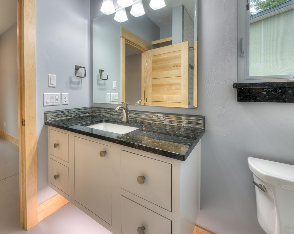 Floating vanity with Bradford door and Slab drawer fronts