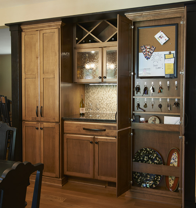 Information Center Maple with Heirloom stain Shakertown II with Full Overlay Slab Drawer Fronts
