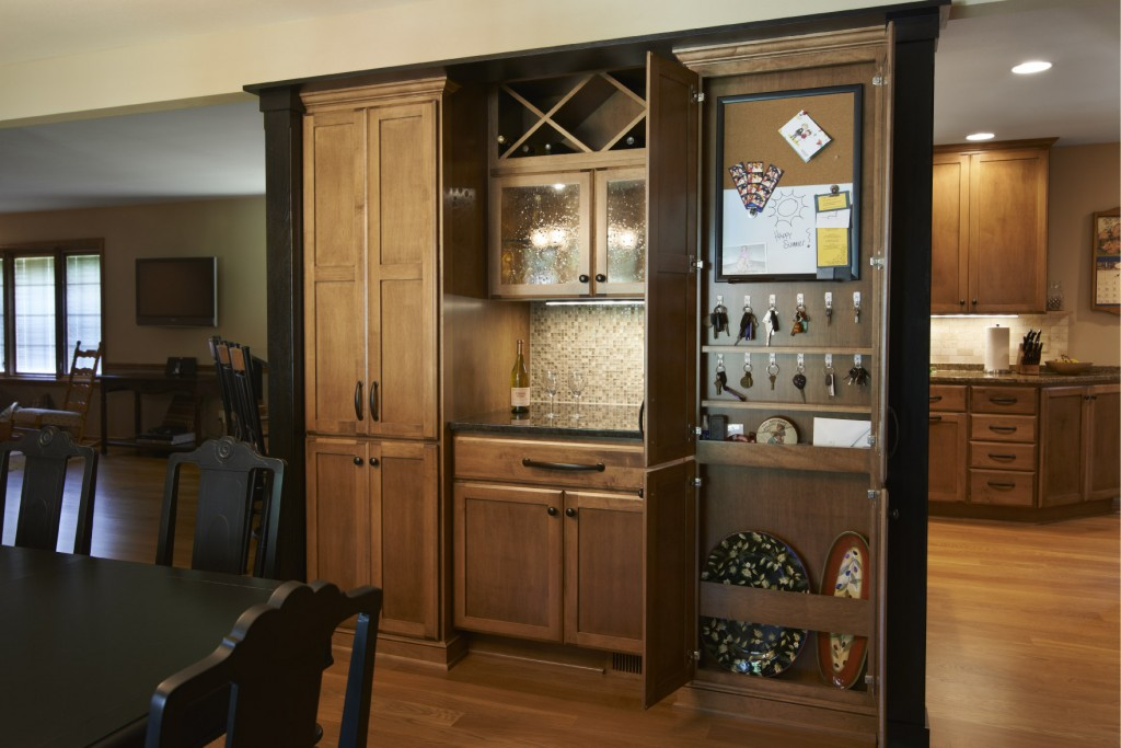 Information Center, Maple with Heirloom stain, Shakertown II with Full Overlay, Slab Drawer Fronts.