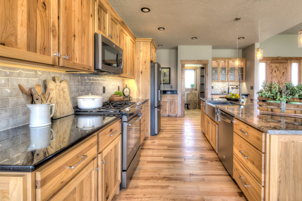 Rustic hickory kitchen with Shakertown IV door style and Slab drawer fronts